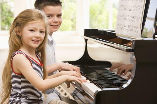 Kids Enjoying Playing Piano