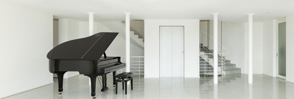 A stunning room built for a piano.
