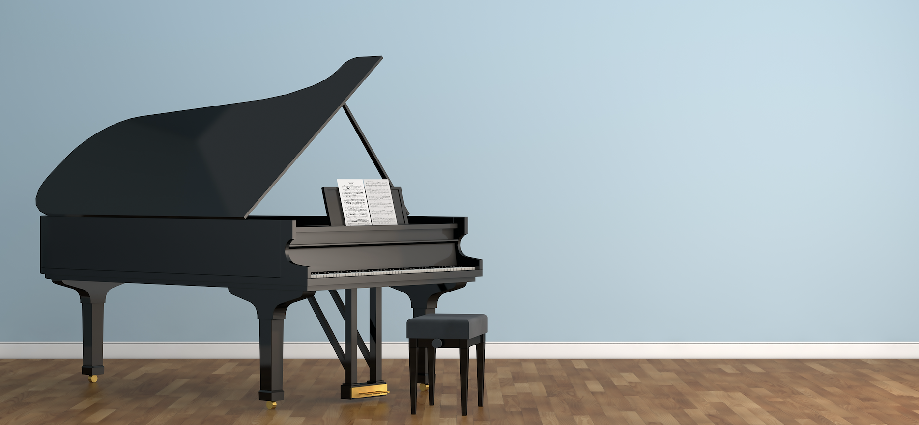 A black grand piano on floor boards with a blue wall.